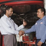 local mechanic and customer shaking hands